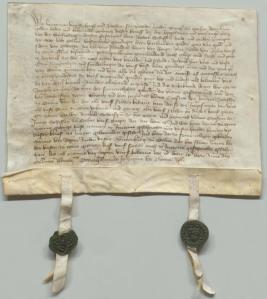Eine spätmittellalterliche Urkunde mit zwei Siegeln.